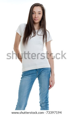 Standing young woman wearing jeans and a white t-shirt - stock photo