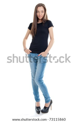 Standing young woman wearing jeans and high-heel shoes - stock photo