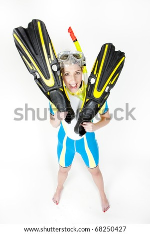 standing young woman wearing neoprene with snorkeling equipment - stock photo
