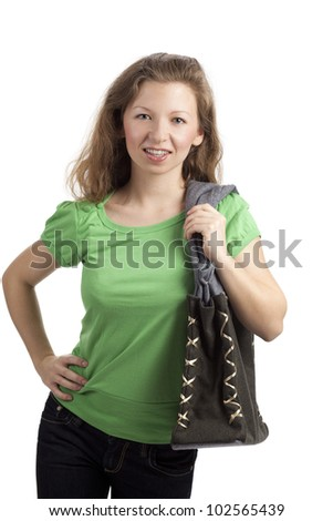 Standing young woman with a bag in traditional style - stock photo