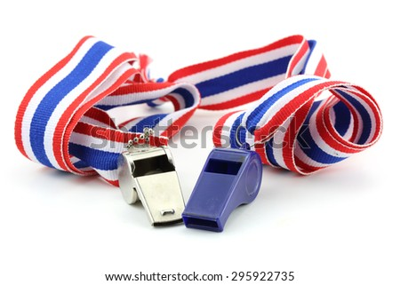standless whistle and blue plastic whistle with Thailand national flag lanyard in heart shape on white background - stock photo