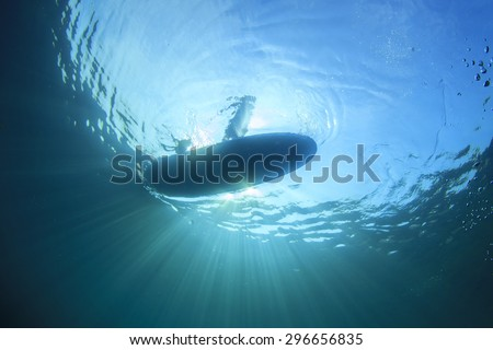 Standup Paddle Board from underwater - stock photo