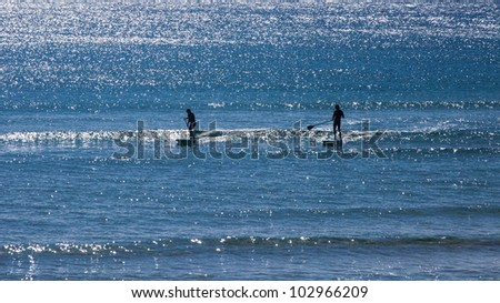 Standup paddle boarding, Coolangatta, Gold Coast, Queensland, Australia - stock photo