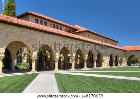 STANFORD, CA/USA - JULY 6: Memorial Court at historic Stanford University.  The university features original sandstone walls with thick Romanesque features. July 6, 2013. - stock photo