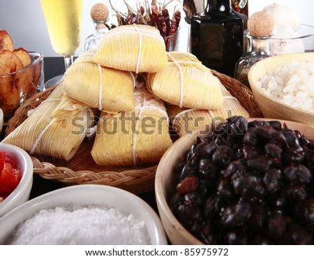 Staple latino sides, manioc, rice, plantains, and black beans - stock photo