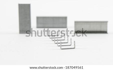 Staple needles isolated on white background - stock photo