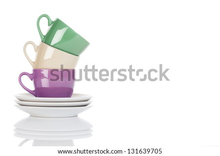 stapled purple, green and beige coffee cups on white background - stock photo