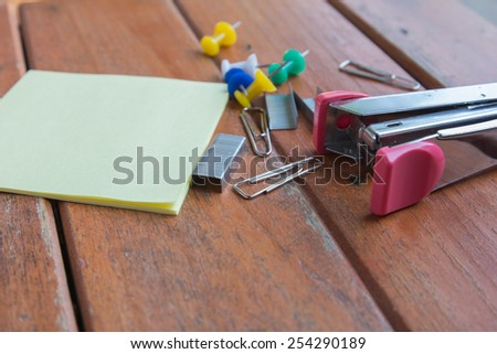 stapler and office supplies on a table - stock photo