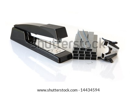 Stapler, staples strips and remover on white background