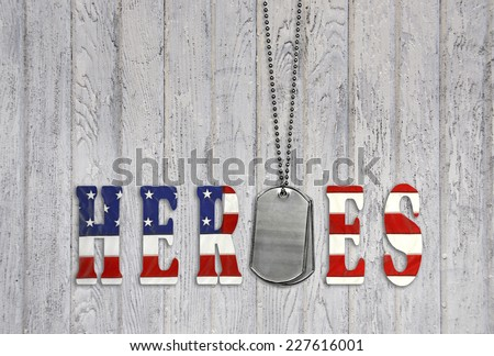 star and stripe font for military heroes with dog tags on weathered wood - stock photo