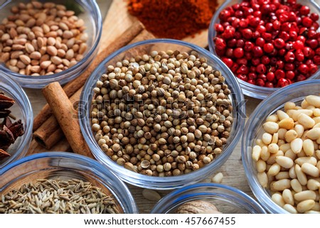 Star anise and other spices on a wooden surface - stock photo