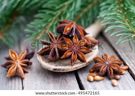 Star anise on wooden ground