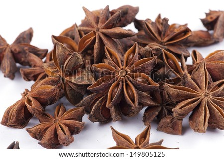 star anise pods on white background - stock photo