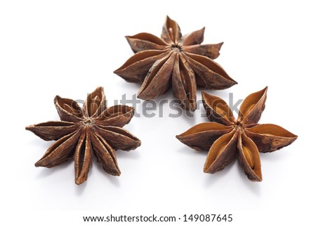 star anise three on white background - stock photo