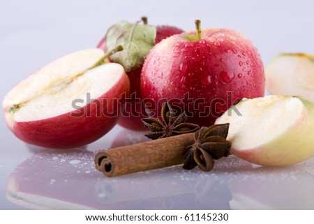star anise with a cane, cinnamon and apples - stock photo