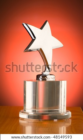 Star award against red gradient background - stock photo