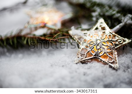 Star christmas lights glowing in the snow - stock photo