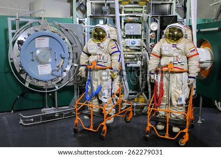 STAR CITY, RUSSIA  MARCH 18, 2015: Orlan spacesuits and airlock operations trainer in the Cosmonauts Training Center for EVA training on ISS exterior - stock photo