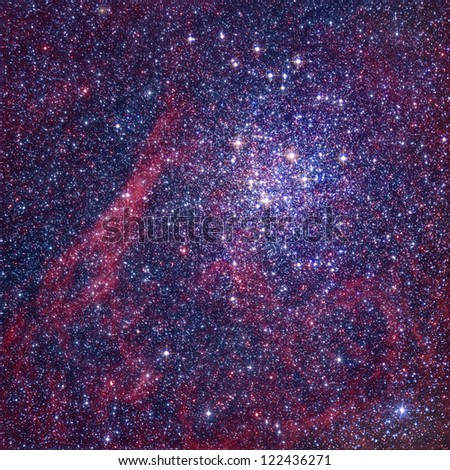Star cluster and red nebula - stock photo