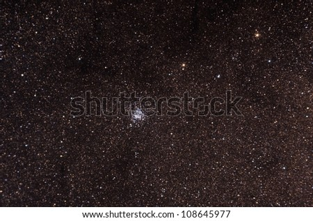 "Star cluster Known as ""wild duck"" star cluster, in the constellation scutum, contains about 2900 stars. This is a very deep and real image, taken by telescope"