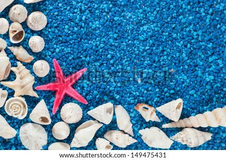 Star-fish and seashells on sand - stock photo