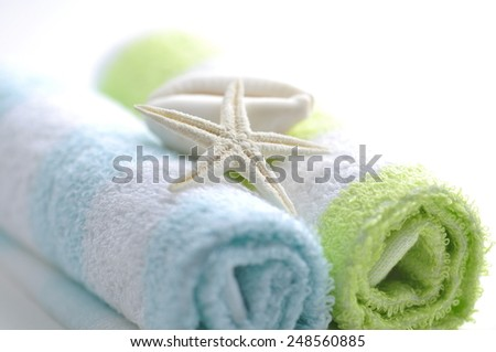 Star fish shell placed on rolled towel - spa object