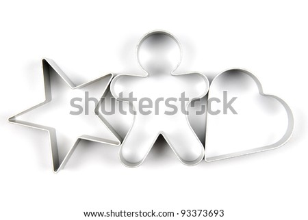 Star, gingerbread and heart pastry cutters on white background - stock photo