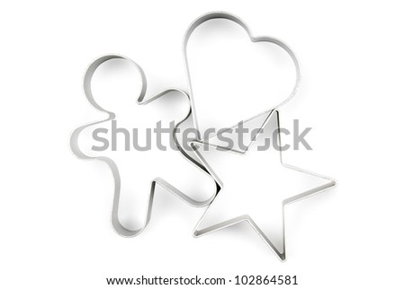 Star, gingerbread and heart pastry cutters on white background. Clipping path included. - stock photo