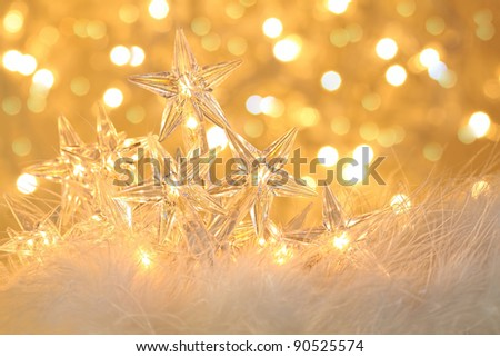 Star holiday lights with gold sparkle background - stock photo