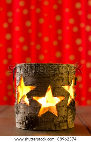Star jar candle holder on a red golden background - stock photo