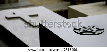 Star of David and Cross on the marble tombstones. Montparnasse Cemetery in Paris (France) - stock photo