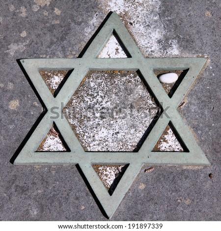 Star of David - Jewish symbol on an old Hebrew grave in Campo Verano cemetery, Rome. Square composition. - stock photo