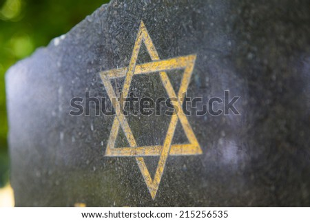 Star of David on an old tombstone in the Czech republic - stock photo