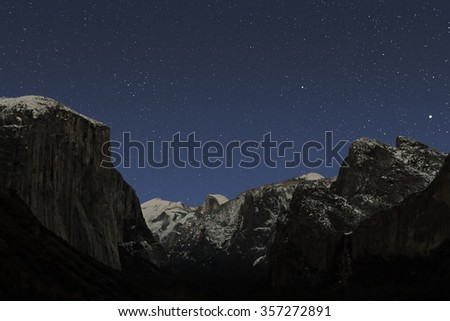 Star scene on a clear December night over Yosemite Valley.  Jupiter, Denebola, Coma Berenices Cluster, Cathedral Rocks, Sentinel Done, Half Dome, Clouds Rest and El Capitan are prominent features. - stock photo