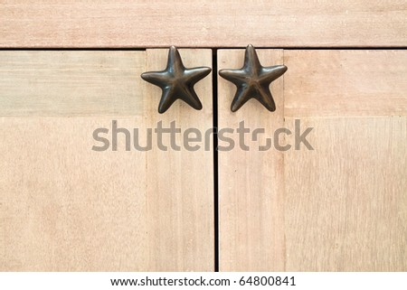 Star-shape cabinet handles - stock photo