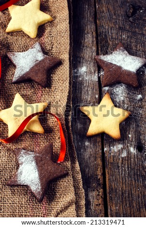 Star shape gingerbread Christmas cookies from above on the wooden table  - stock photo