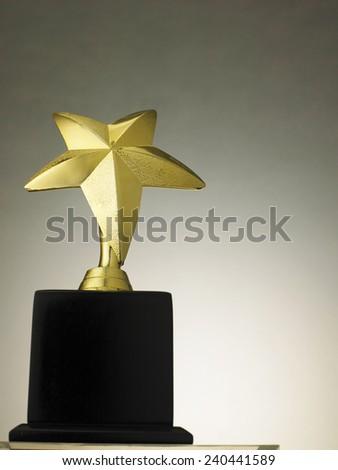 star shape trophy for winner - stock photo