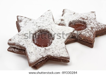 Star shaped chocolate cookies on white - stock photo