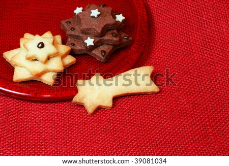 Star shaped christmas cookies on a plate with copy space - stock photo