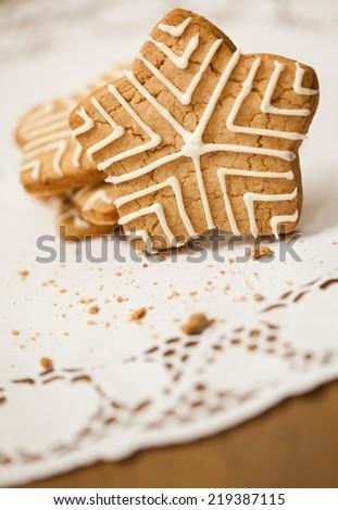 Star shaped Christmas cookies - shallow DOF. - stock photo