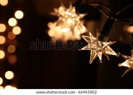 Star shaped Christmas lights on dark background. Shallow dof, copy space. - stock photo