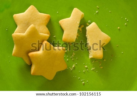 Star shaped cookies on a vibrant green plate - stock photo