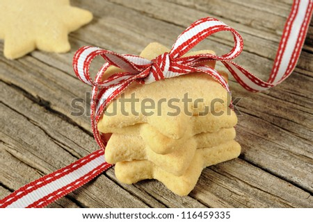 Star shaped cookies with red ribbon - stock photo