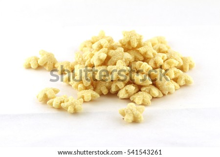 star-shaped dry breakfast cereal isolated on white background