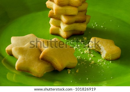 Star shaped sugar cookies on a vibrant green plate - stock photo
