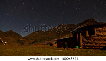Star stripes in the sky at night in the mountains - stock photo