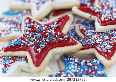 Star sugar cookies decorated for 4th of July Independence day celebration in America. Icing and sprinkles in red, white, and blue. selective focus. Very little depth of field. - stock photo