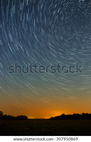 Star trail in the night sky with bright meteors and aircraft lights.