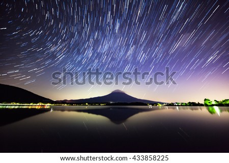 Star trail, Mount Fuji and Lake Tanuki in Japan.  - stock photo