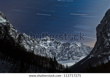 Star trails in the mountains with Triglav, the highest mountain in Slovenia (Europe).